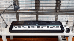 The Yamaha DGX670 songwriting machine on a table top in a modern apartment